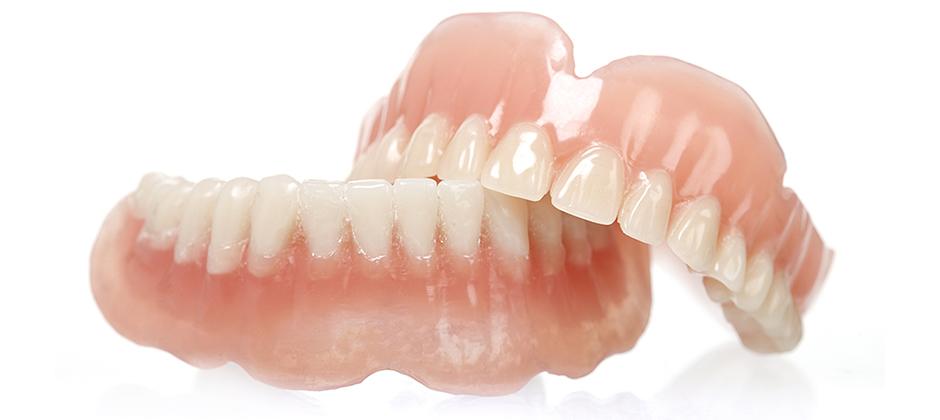 meglio la dentiera o gli impianti